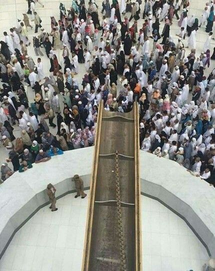An amazing view of the Meezab ar Rahmah ( the golden spout ) taken from the roof top of the kabah # Mecca