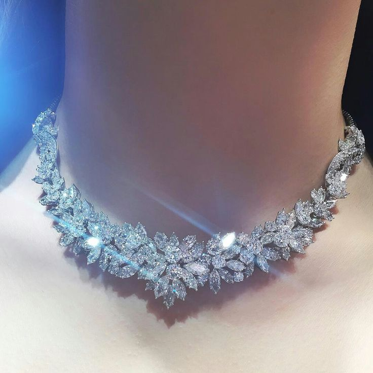The front designed as a cluster of marquise and circular-cut diamond flowerheads, joined to the scrolling baguette and circular-cut diamond link, extending to the backchain and diamond clasp. I'm in love with this exquisite diamond necklace by #Bulgari #ChristiesJewels #DiamondNecklace