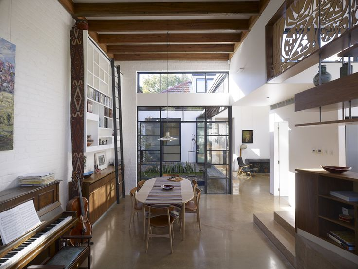 polished concrete floor, charcoal windows and a courtyard