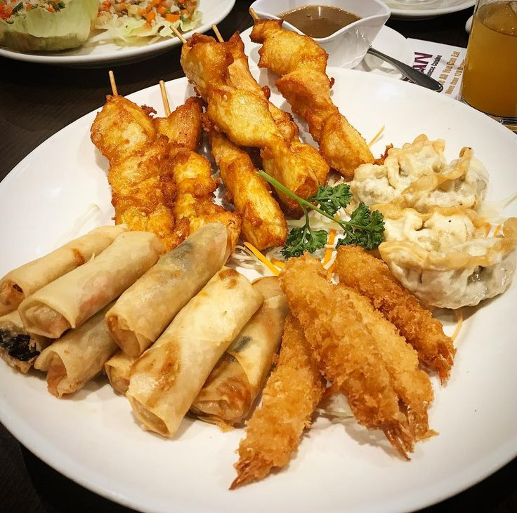 Massive plate of Chinese starters from a local made to order Buffet. Picked a mix of Spring Rolls Breaded Crab Claws Fried Dumplings and delicious Chicken Satay. To be honest if I wasnt with other people I probably could have eaten about 5 plates of these before I got my main courses  dish?#chinesefood #springrolls #crab #crablegs #seafood #dumplings #dimsum #fried #chicken #satay #sauce #peanuts #allyoucaneat #buffet #delicious #chinese #restaurant #authentic #food #family #dinner #foodporn…