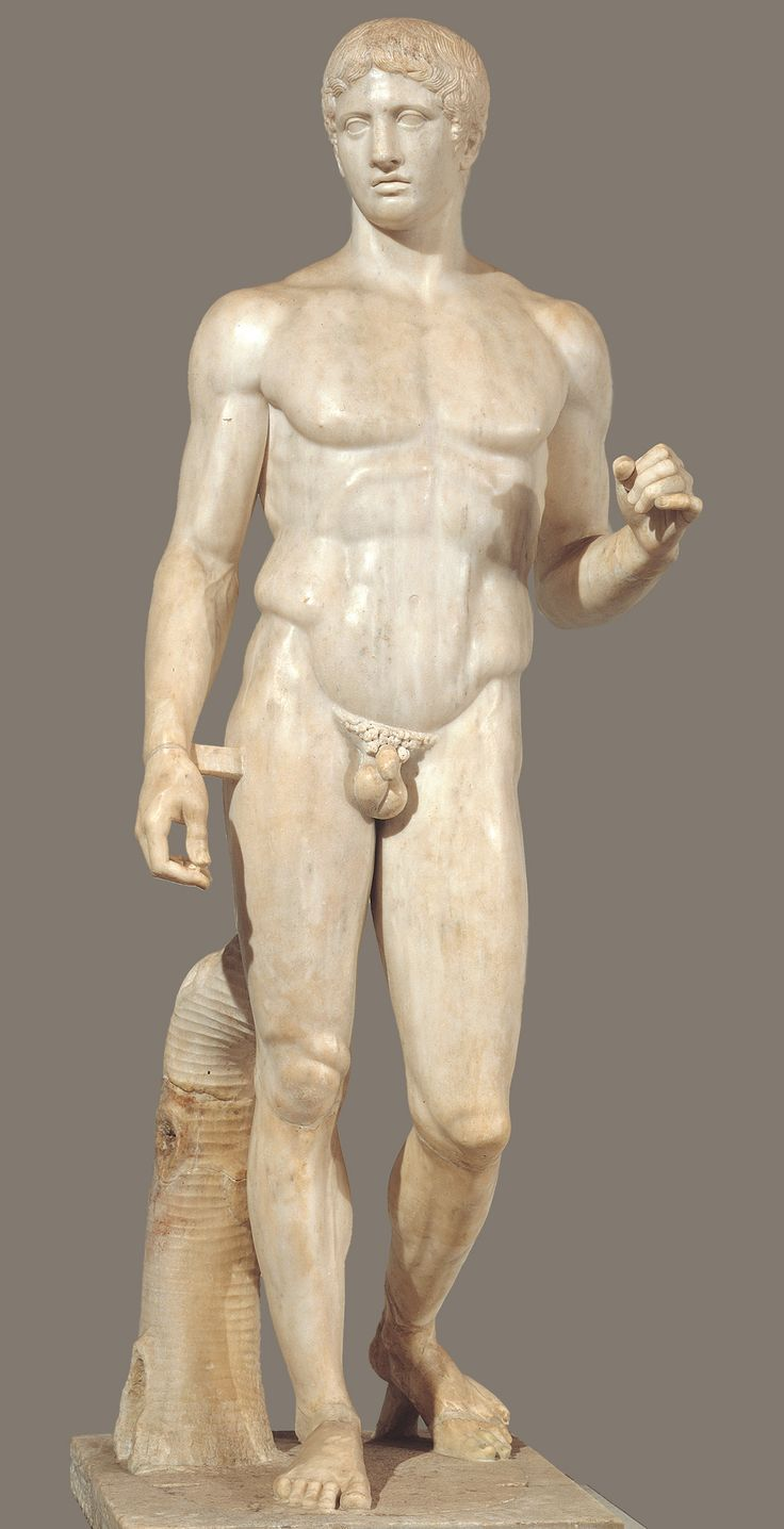 POLYKLEITOS, Doryphoros (Spear Bearer).  Roman copy from the palaestra, Pompeii, Italy, of a bronze statue of ca. 450-440 BCE.  Marble, 6′ 11″ high.  Museo Archeologico Nazionale, Naples.