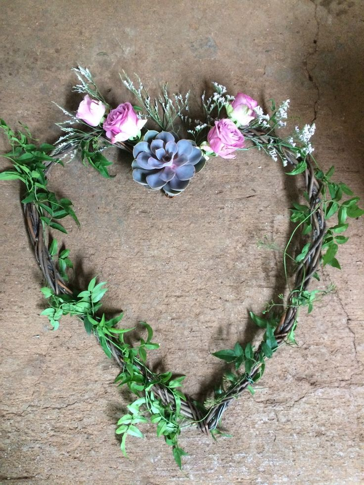 Wooden Heart with purple Rock rose and cool water roses.