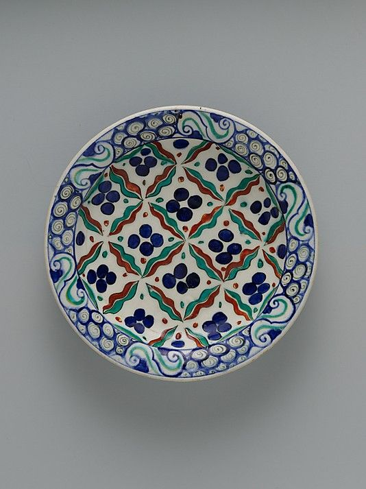 Dish with 'Cintamani' and tiger-stripe pattern | Iznik, Turkey, ca. 1575-1590 | Stonepaste; polychrome painted under transparent glaze | The pattern of this dish is a variant of the  'chintamani' (Sanskrit for 'auspicious jewel') design | This  design originated in Buddhist iconography. The circles and wavy stripes represented flaming pearls, but this significance was transformed by the Ottomans into tiger stripes and leopard spots, symbols of strength | The Metropolitan Museum of Art, New…