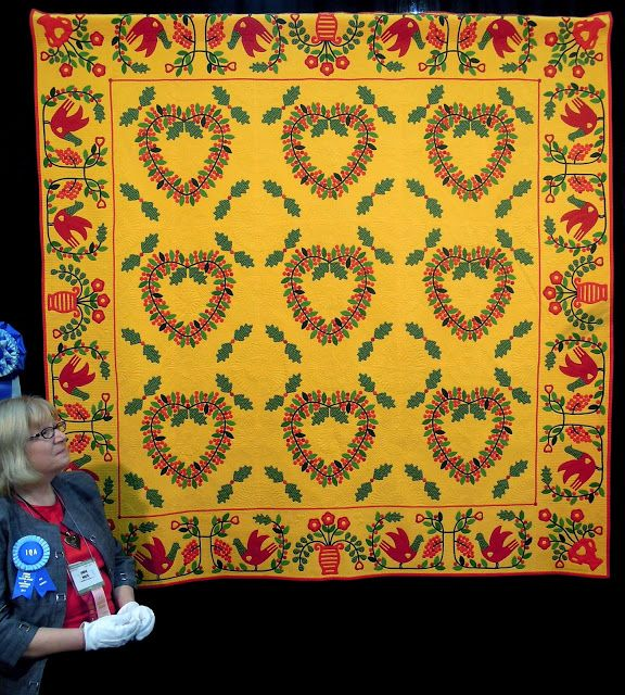 """Forever In My Heart""  by Lahala Phelps, Bonney Lake, Washington. 2013 Houston IQF. Inspired by an 1885 vintage quilt,  'Bleeding Heart' by Mary Ann Crowe, in: A Treasury of Mennonite Quilts (Rachel and Kenneth Perlman).  Photo by Quilt Inspiration."