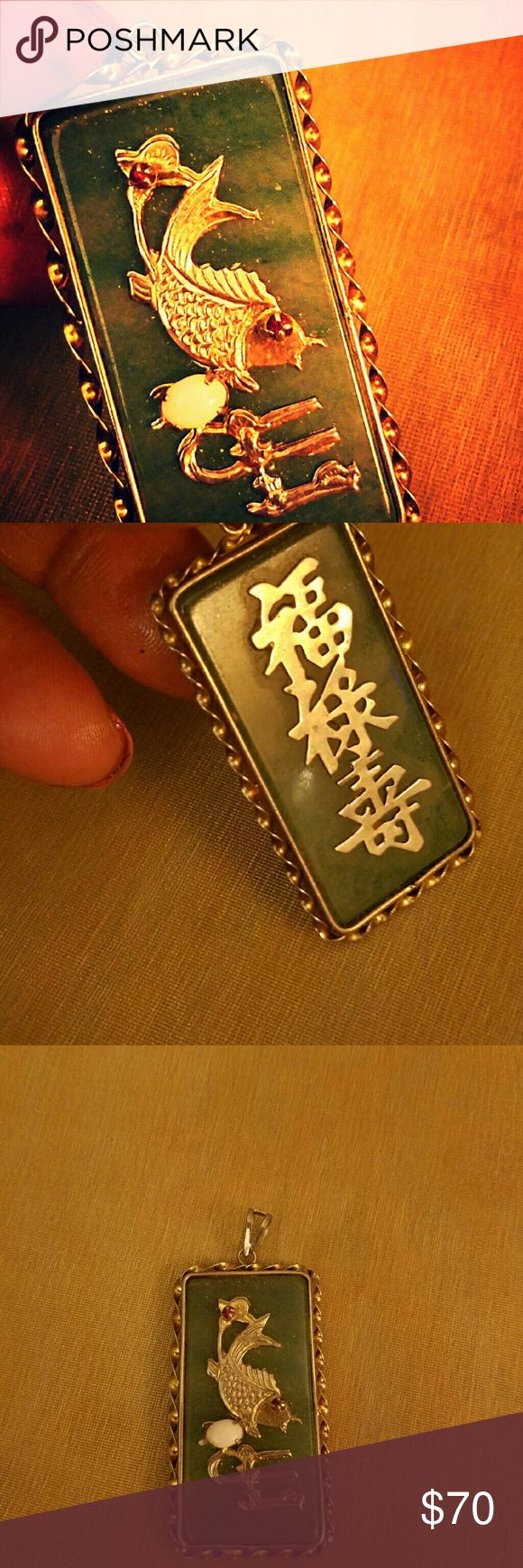 Jade pendant Beautiful! Chinese pendant.  You can see the back of the pendant has a Chinese inscription.  Does anyone know what it means??? Please let me know. Two rubies with a white opal, Sterling silver trimming with gold plated Jewelry