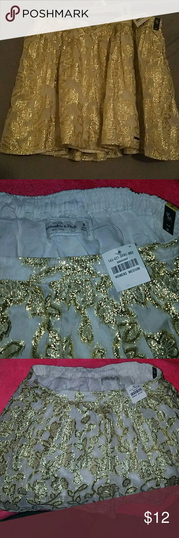 Holiday ready.. Nwt abercrombie skirt Get ready to party with this shiny gold and cream skirt from abercrombie and Fitch size medium skirt. Nwt Abercrombie & Fitch Skirts Mini