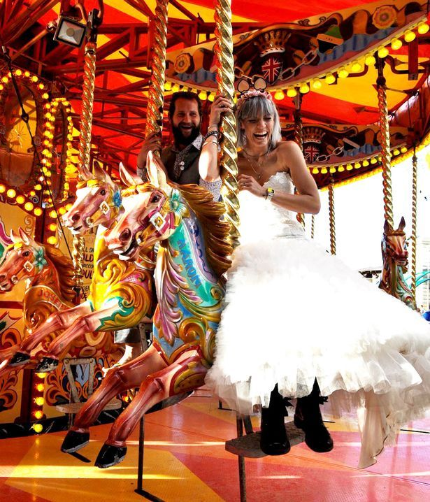This couple shunned their dream honeymoon in Cuba to spend their time in Banksy's Dismaland theme park instead. They even dressed up in their wedding outfits, including the bride's gorgeous white wedding dress, for the anti-Disneyland attractions - and the pictures are amazing.