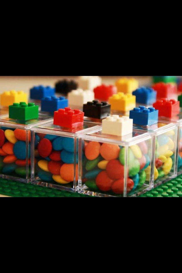 Clear jars. Glue Lego on top of each lid for a handle. Fill with snack!