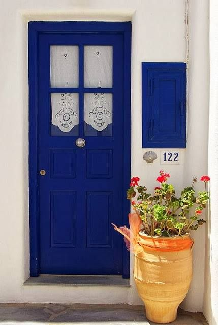 Beautiful blue door with lace curtains