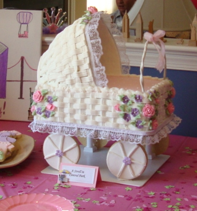 Baby carriage cake with sugar cookie wheels.