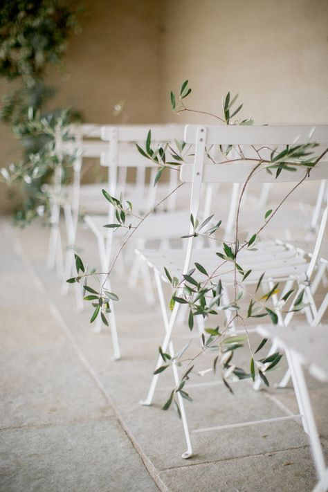 Bistro chairs wrapped on olive branches: http://www.stylemepretty.com/2016/11/18/black-tie-south-of-france-wedding/ Photography: Brosan Photographic - http://www.brosnanphotographic.com/