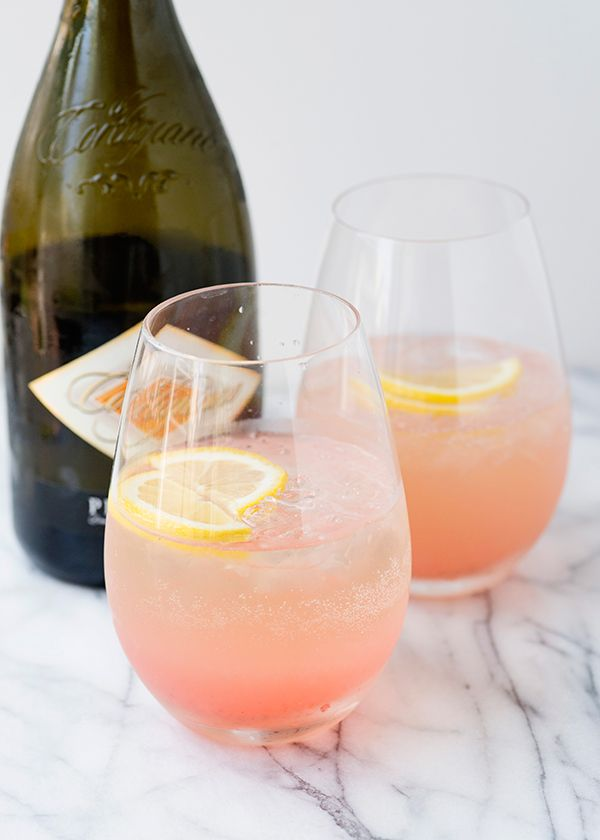 Rhubarb Fizz    8 ounces gin  9 ounces rhubarb syrup  1/2 cup fresh lemon juice  12 ounces cold Prosecco  ice  lemon rounds for garnish