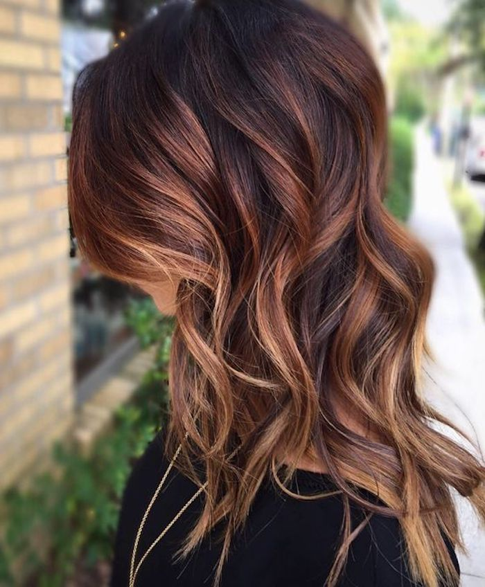 Reddish Brown Dark Hair With Blonde Highlights Curled And Worn By Woman In A In 2020 Brown Blonde Hair Brown Hair With Blonde Highlights Blonde Highlights On Dark Hair