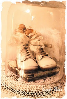 vintage baby shoes under a cloche, im going to add my 45 year old plunket book in there as well.