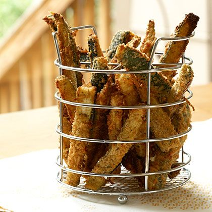 Summer zucchini is bountiful right now. And if you (or your neighbors) have a garden, you're likely loaded down with the green stuff. Put it to delicious use with these zucchini fries. | Health.com
