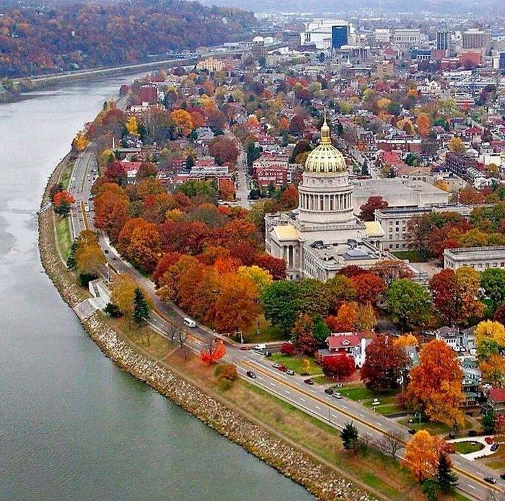 The beautiful gold dome of West Virginias Capitol building along the Kanawha River in Charleston...