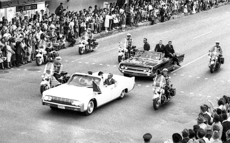 11/21/63 - President and Mrs. Kennedy ride with Governor John Connally in a motorcade through downtown Houston, heading for the Rice Hotel. The time is approximately 5:15-5:30 pm.