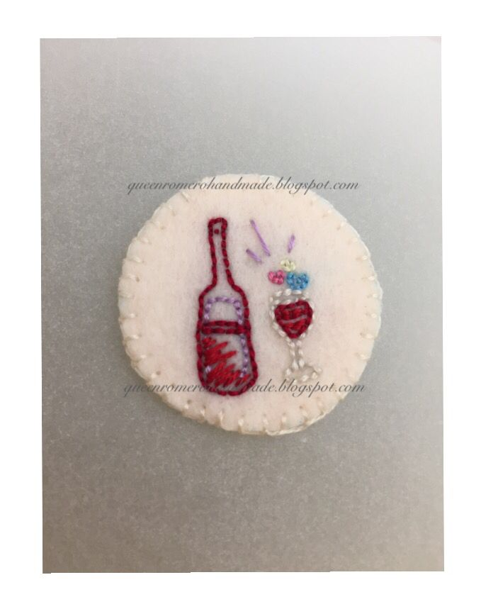 """hand-embroidered patch, 4 cm. (diameter), embroidered on felt w/ felt backing, original """"red wine"""" drawing"""