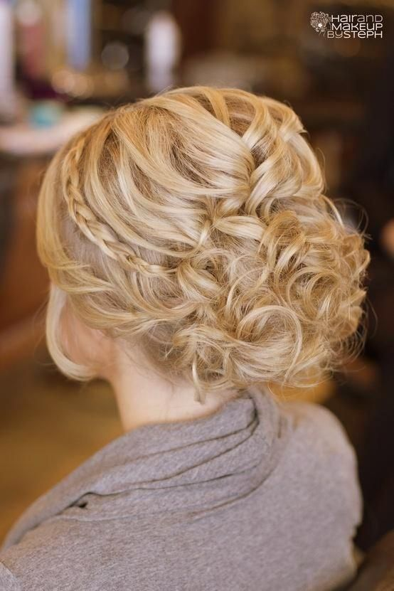 Another 25 Bridal Hairstyles  Wedding Updos | Confetti Daydreams -  A thin braid wrapped over the hairdo, crowns this hairstyle off  #Wedding #Bridal #Hair #Updo #Hairstyle