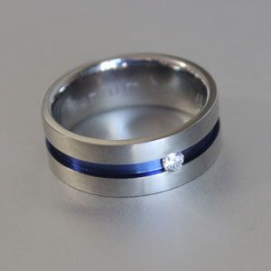 titanium ring with blue groove and white diamond