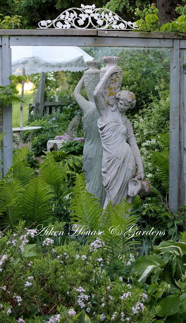 Mirrored statue. I included this because it's a beautiful way to 'extend' a smaller garden.