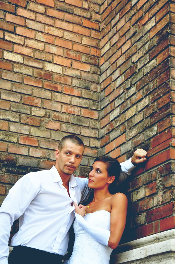 couple in front of a brick wall
