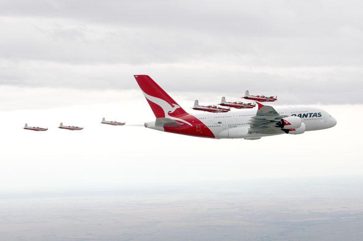 The Royal Australian Air Force aerobatic demonstration team, The Roulettes, escort a Qantas Airbus A380...