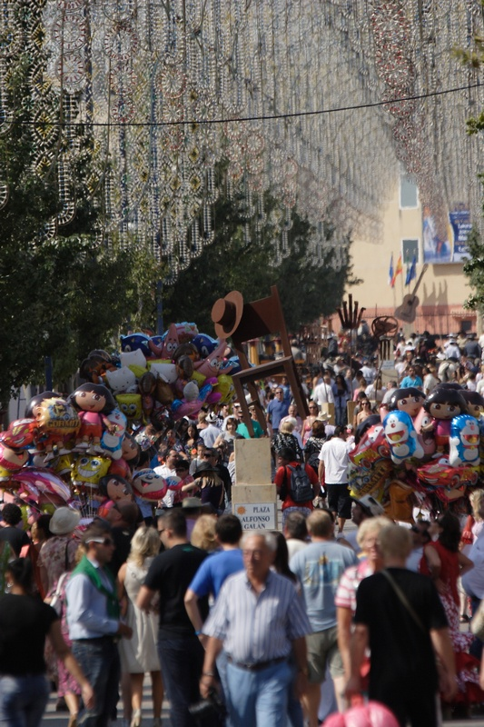 """La Feria del Rosario de Fuengirola (octubre) destaca por su ambiente típicamente andaluz, su carácter abierto, la elegancia de los trajes de gitana y de corto y por la importancia del caballo. Fuengirola Fair (October) is one of the most important in Andalusia. It is a very open celebration. And it is very smart too because of the colourful and typical """"trajes de gitana"""" as well as the massive presence of horses in the Recinto Ferial (Fuengirola, Málaga, Andalucia, Andalusia, España, Spain)"""