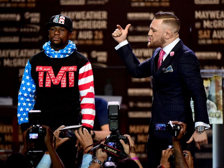 Conor McGregor brings super-fight to life with cutting trash talk about Floyd Mayweather's taxes, size, and boxing style - Conor McGregor and Floyd Mayweather on Tuesday kicked off their four-city promotional tour with a press conference in Los Angeles that showcased the showmanship of both fighters.  Some have joked that the press conference should cost money to view while the fight should be free — a testament to both fighters' marketing genius and McGregor's chances of beating Mayweather…