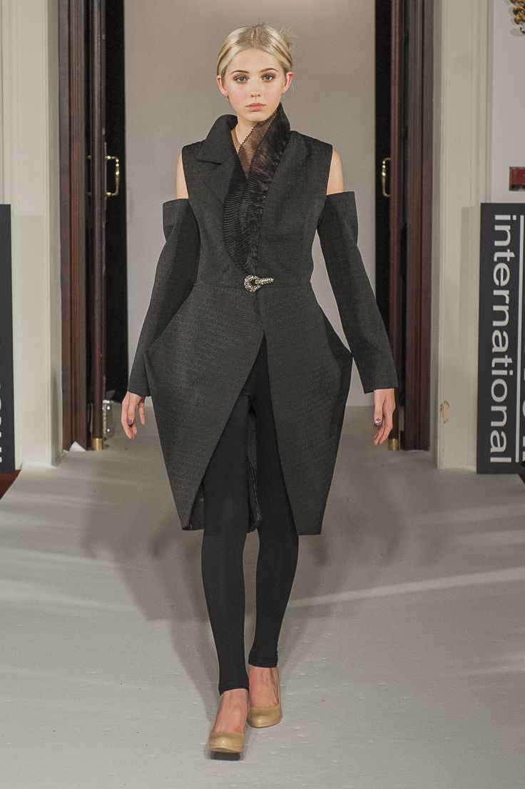 "Lenie Boya ""Dramatique"" Collection at London Fashion Week S/S 2016 Haute Couture. Black asymmetric collar coat with peaked futuristic hips and organza back."