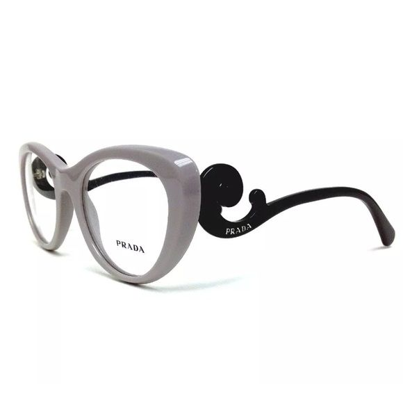 Prada Baroque Gray Black Eye Glass Frames NWB New Prada Authentic Baroque gray and black eyeglasses. Gorgeous glasses with a cat eye style frame. Comes with box and case.  Eye 51mm bridge 21mm temple 140mm.  Has stock lenses Prada Accessories Sunglasses