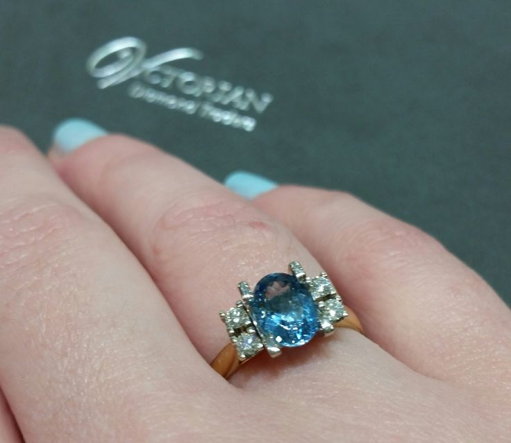18ct yellow gold blue topaz ring with diamonds