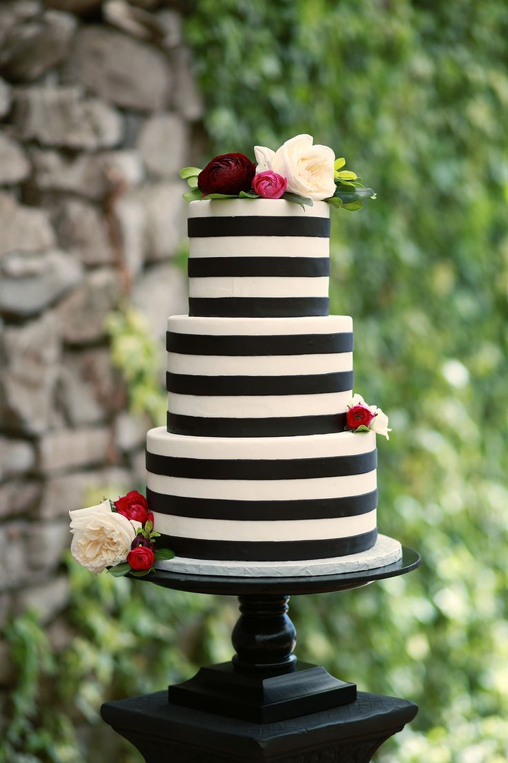 Black and white striped cake at this Emerald Fantasy Wedding Inspiration   photography Jessica Lee Photographic Art   The Pink Bride® www.thepinkbride.com