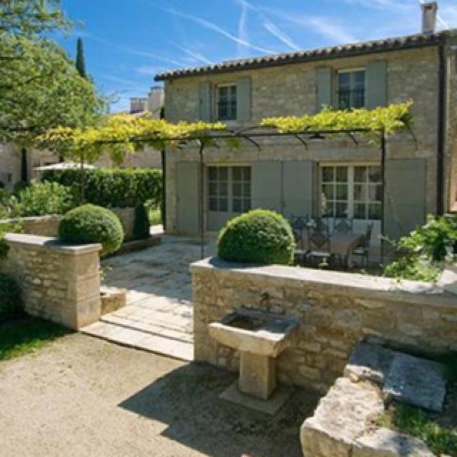iron pergola + walled courtyard