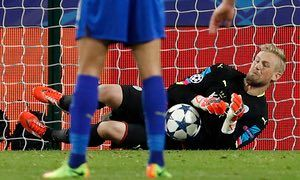 Leicester City's Kasper Schmeichel guesses correctly and saves Steven N'Zonzi's penalty,