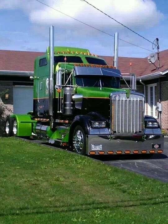 What a beauty this high bunk custom Kenworth W900 is! A real looker in black with bright green contrast.
