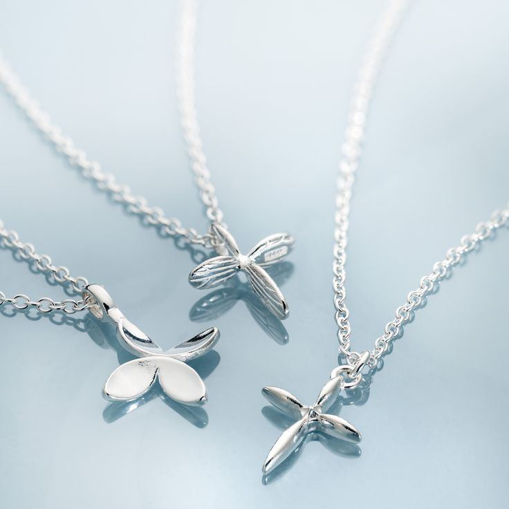 Kalevala Koru / Kalevala Jewelry / CROSS OF FRIENDSHIP, CROSS OF HOPE & CROSS OF HAPPINESS design Tiina Lahtinen