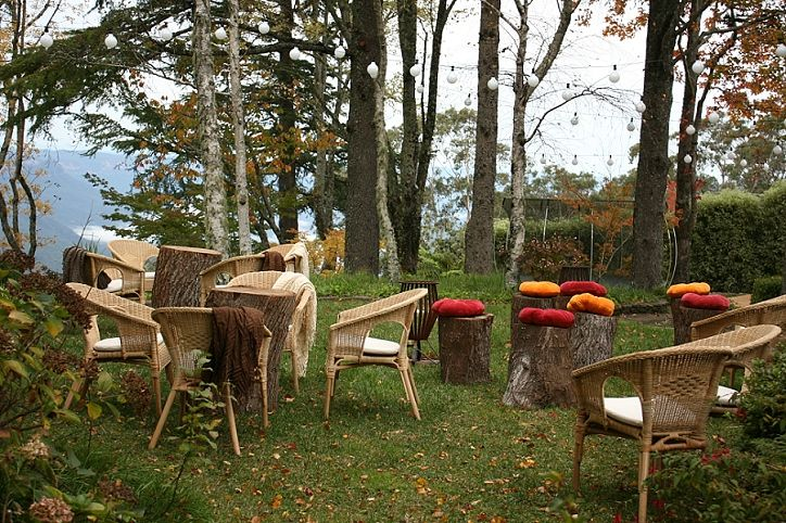 by us: timber log stools and tables, and wicker chairs, for the perfect woodland…