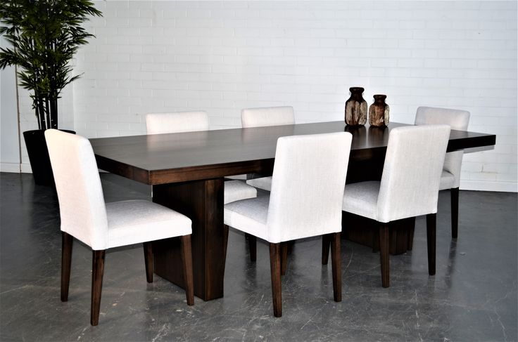 Loving the contrast between the dark table and white chairs...? so do we! Very stylish and modern whilst still keeping a natural touch.  We custom make furniture to your specifications, contact us for more info!