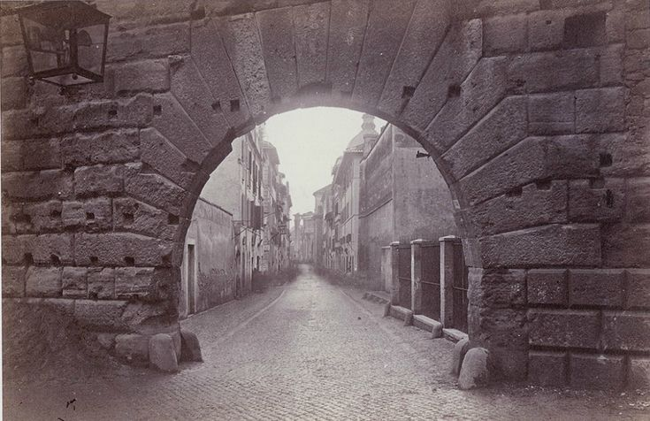 Rome, Arco di Pantano, in the Forum of Augustus, with the street leading to the Forum Romanum (1866-1869)