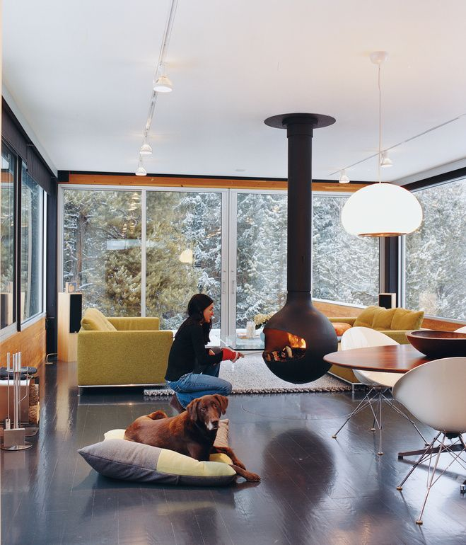 To avoid a space-hogging fireplace, architect Michael P. Johnson recommended a Bathyscafocus by Focus Creations for the Hiller House. Hil...