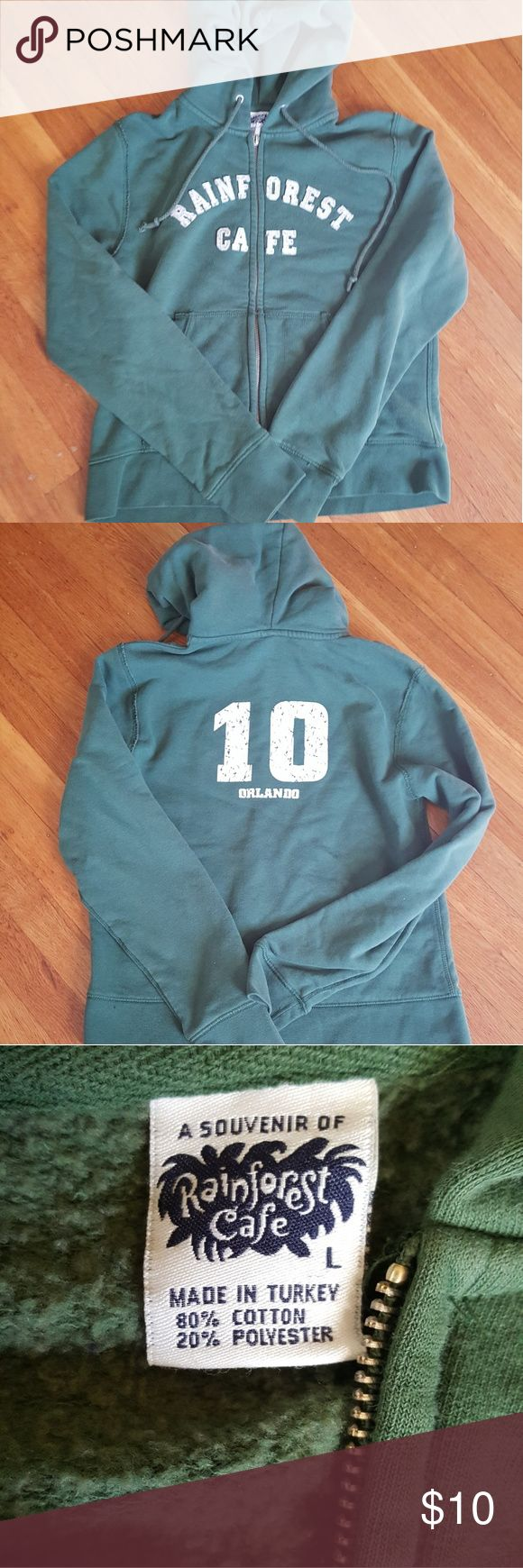 Orlando Rainforest Cafe Green Hoodie Size Large Rainforest Cafe Orlando green hoodie in a size Large.  Worn a couple of times.  Really comfy! Rainforest Cafe Tops Sweatshirts & Hoodies