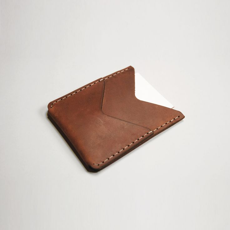 """Designed for your essentials this slim double pocket wallet features a front pocket to secure and show your metro pass.Handcrafted in Toronto, Canada.Boomer Brown Leather Size: 3.75"""" x 3"""""""