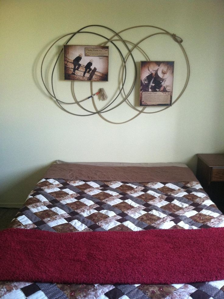 Fill headboard space with lasso and cowboy pictures in a western themed room.