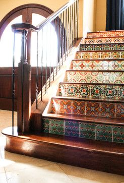 :Kinda cool idea to dress up stair case and not have kick marks  on the white painted portion