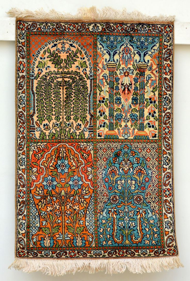handmade silk kashmir carpet. Qum design with turquoise and burnt orange and hues of cream+gold