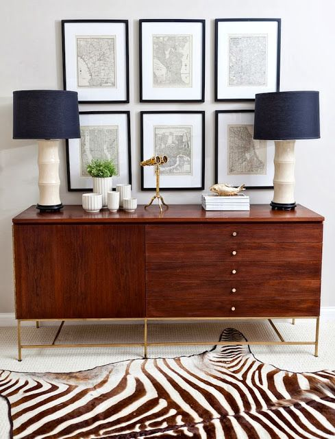 Clean, symmetrical disposition of elements create a beautifully simple yet eye catching vignette. Love the zebra rug!