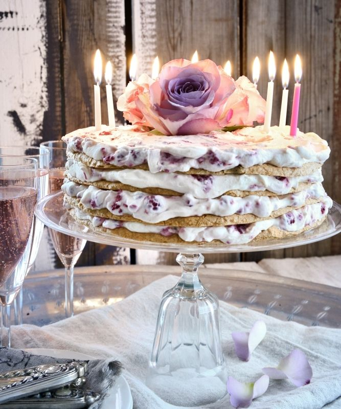 Party Cake With Raspberries and Lime Creme _ Delicate almond fragile - Meringue bottoms with sweet and fresh raspberries and lime cream, garnished with fresh #roses. Now the party begin!