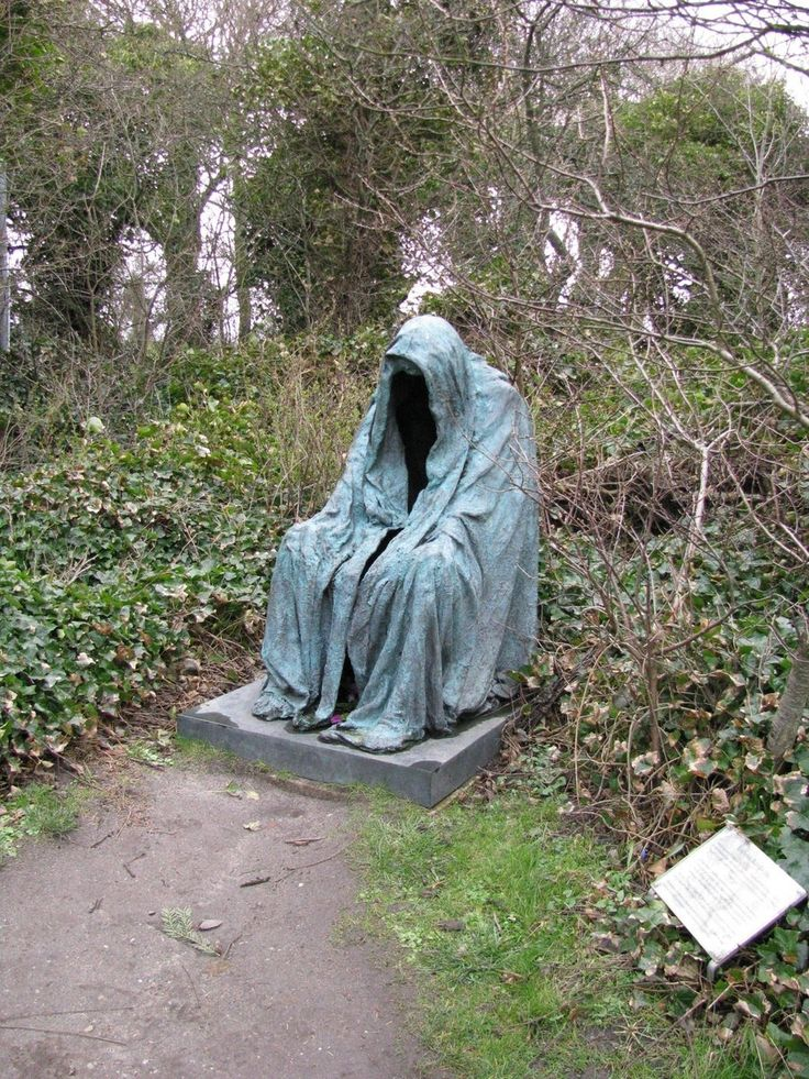 spooky cemetery statue