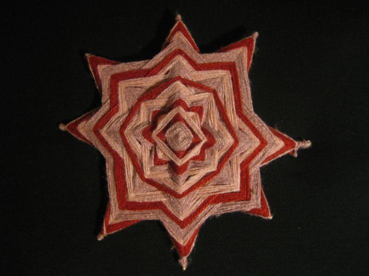 Mandala de lana de 8 puntas. 24x24 cms. USD 6.